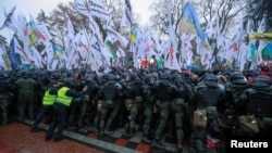 Ukrainian law enforcement officers block demonstrators during a rally held by entrepreneurs and representatives of small businesses near the parliament building amid the coronavirus disease (COVID-19) outbreak in Kyiv, Ukraine November 17, 2020.