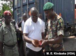 Military officials examine ammunition.