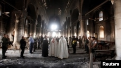 Iraqi priests hold the first mass at the Grand Immaculate Church since it was recaptured from Islamic State in Qaraqosh, near Mosul, Iraq.