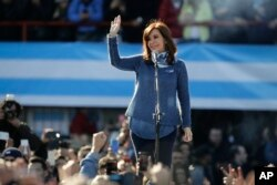 Argentina's former President Cristina Fernandez waves during a rally on the outskirts of Buenos Aires, June 20, 2017. Fernandez appeared before thousands of followers to launch the new political front Unidad Ciudadana or Citizens Unity Party.