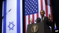 President Barack Obama gestures during his speech at the Jerusalem Convention Center, March 21, 2013.