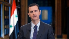 FILE -  Syrian President Bashar Assad speaks during a television interview.