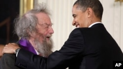 FILE - President Barack Obama presents a 2010 National Medal of Arts to poet Donald Hall, during in a ceremony in the East Room of the White House in Washington, March 2, 2011.
