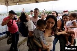 People cross the Colombian-Venezuelan border over the Simon Bolivar international bridge in Cucuta, Colombia, April 2, 2019.