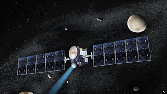 Artist's concept of NASA's Dawn spacecraft. The giant asteroid Vesta, Dawn's current destination, is on the lower left. Another larger asteroid and Dawn's second destination, Ceres, is on the upper right