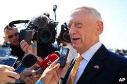 FILE - Secretary of Defense Jim Mattis speaks to reporters about North Korea at the Pentagon, May 25, 2018.