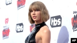 FILE - Taylor Swift arrives at the iHeartRadio Music Awards in Inglewood, California, April 3, 2016.