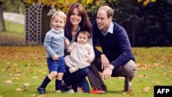 A handout photo obtained in London on Dec. 18, 2015, shows Britain's Prince William (R), Catherine, Duchess of Cambridge (2nd L) and their two children Prince George (L) and Princess Charlotte at Kensington Palace.
