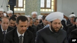 Syrian President Bashar Assad and Grand Mufti Ahmad Badreddin Hassoun (right), attend a religious festival in Damascus. (File Photo)