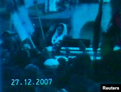 A television still released on December 28, 2007, one day after her assassination, shows former Pakistan prime minister Benazir Bhutto moments before she died following a rally in Rawalpindi.