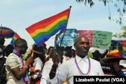 People who identified themselves as members of the lesbian, gay, bisexual and transgender (LGBT) community parade in Entebbe, southwest of Uganda's capital, Kampala, Aug. 8, 2015.