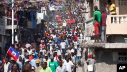 FILE - Protesters chant anti-government slogans during a protest against President Michele Martelly's government to demand the cancellation of the Jan. 24, elections, in Port-au-Prince, Haiti, Jan. 18, 2016.
