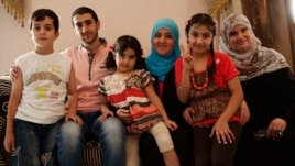 Syrian activist Soad Khadeya (third from right wearing a blue hijab) has opened her home near Cairo to other Syrian refugees, September 11, 2013. (Yuli Weeks for VOA)