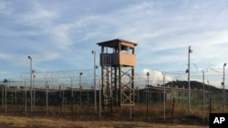 This Dec. 11, 2016, photo shows an unused guard tower at Camp Delta, one of the parts of the detention center at the U.S. naval base at Guantanamo Bay, Cuba, that is now vacant as the detainee population reaches 59, the lowest it has been since early 2002.