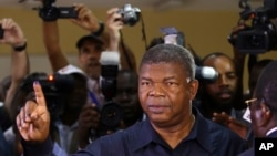 Angola's MPLA main ruling party candidate and defense minister, Joao Lourenco, shows his ink-stained finger after casting his vote in Luanda, Angola, Aug. 23, 2017. Lourenco is the front-runner to succeed President Jose Eduardo dos Santos, who will step d
