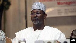 FILE - Nigeria's ex-electoral chief and academic Attahiru Jega attends a meeting with staff from the Independent National Electoral Commission in Abuja, March 17, 2011.