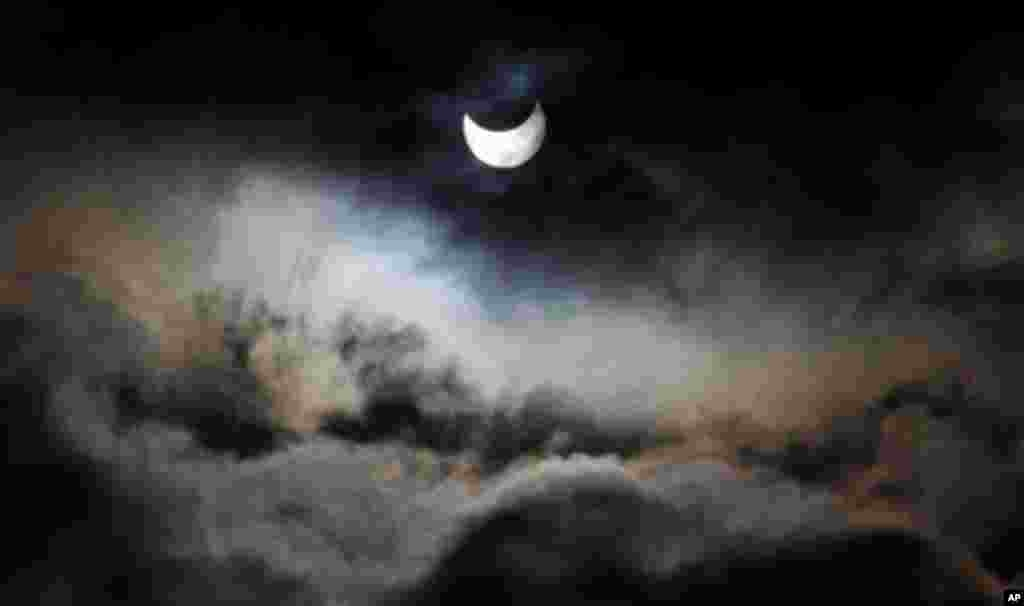 A view of a partial solar eclipse as seen from Gaza City. (Hatem Moussa/AP)