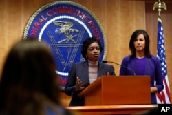 Federal Communications Commission Commissioners Mignon Clyburn, left, and Jessica Rosenworcel answer a question from the media after an FCC meeting to vote on net neutrality regulations, Dec. 14, 2017, in Washington.