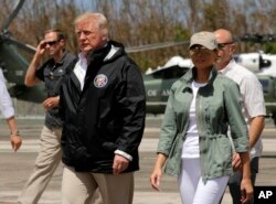FILE - President Donald Trump and first lady Melania Trump walk after arrival at the Luis Muniz Air National Guard Base in San Juan, Puerto Rico, Oct. 3, 2017.