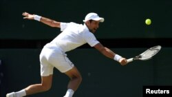 Serbia's Novak Djokovic in action at Wimbledon during the men's singles final against South Africa's Kevin Anderson, July 15, 2018.