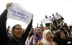 FILE - Jobless archeology graduates protest in demand of jobs in the Egyptian museum, in Cairo, Egypt, Feb 16, 2011.