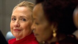 Clinton looks toward South Africa's Foreign Minister Maite Nkoana-Mashabane, during the US-South Africa Business Partnership Summit in Pretoria, South Africa, Tuesday, Aug. 7, 2012.