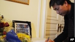 Yap Kimtung, president of Cambodian American for Human Rights and Democracy, signed in, while at the embassy.
