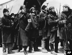 FILE - In this 1965 image provided by MGM, Yuri Zhivago, played by Omar Sharif (2nd from L), is shown arriving with replacement Russian troops in a scene from the film 'Doctor Zhivago.'