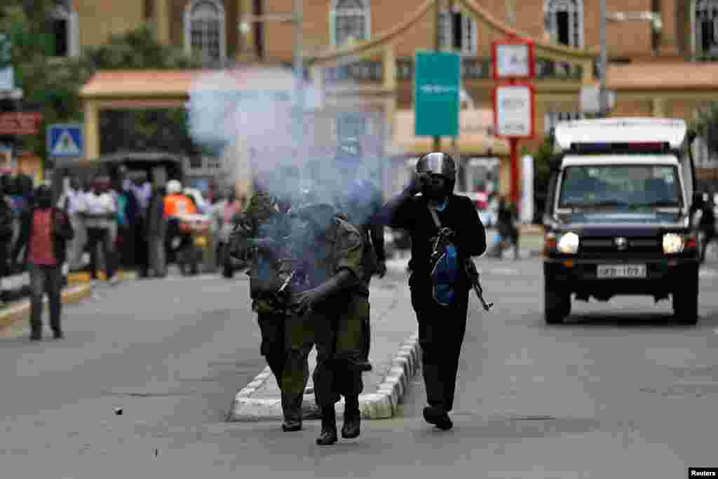 Riot policemen fire tear gas to disperse supporters of Kenya's opposition National Super Alliance (NASA) coalition during a protest in Nairobi.