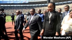 FILE: In this Sunday, Aug. 26, 2018 file photo Zimbabwean Deputy President Constantino Chiwenga is seen with his wife Marry, right, upon arrival for the inauguration ceremony of President Emmerson Mnangagwa, at the National Sports Stadium in Harare.