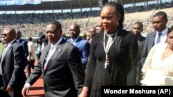 FILE: GOOD OLD DAYS ... imbabwean Deputy President Constantino Chiwenga is seen with his wife Marry, right, upon arrival for the inauguration ceremony of President Emmerson Mnangagwa, at the National Sports Stadium in Harare.