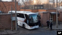 Buses believed to be carrying expelled diplomats leave the U.S. Embassy in Moscow, Russia, April 5, 2018. Russia last week ordered 60 American diplomats to leave the country by Thursday, in retaliation for the United States expelling the same number of Russians.
