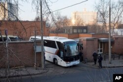 Buses believed to be carrying expelled diplomats leave the U.S. Embassy in Moscow, Russia, April 5, 2018. Russia last week ordered 60 American diplomats to leave the country by Thursday, in retaliation for the United States expelling the same number of Ru