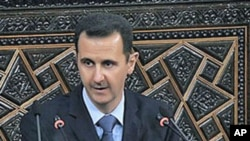 Syrian President Bashar al-Assad addresses the nation during a speech in Damascus, Syria