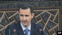 Syrian President Bashar al-Assad addresses the nation during a speech in Damascus, Syria