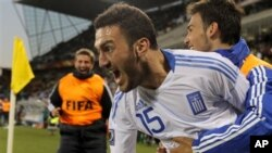 Greece's Vassilis Torosidis elebrates after scoring during the World Cup group B soccer match between Greece and Nigeria at Free State Stadium in Bloemfontein, South Africa, 17 Jun 2010
