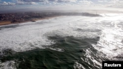 FILE - An aerial view shows breaking waves along the ocean beach front in Biarritz on the southern Atlantic Coast of France, Feb. 5, 2014.