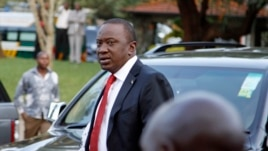 Presidential candidate Uhuru Kenyatta arrives to take part in a televised debate, in Nairobi, February 11, 2013.