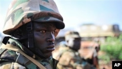 Member of Ugandan contingent of AMISOM forces during advance with Somali National Army to Baidoa from Ballidoogole airbase, Somalia, Oct. 18, 2012.