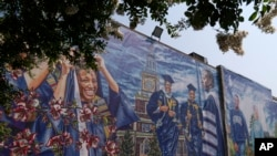 A graduation themed printed mural is seen on the Howard University campus, Tuesday, July 6, 2021, in Washington. (AP Photo/Jacquelyn Martin)