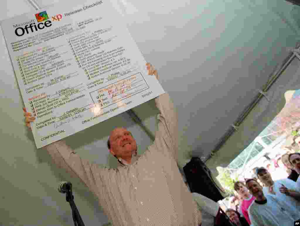 Microsoft CEO Steve Balmer holds a placard checklist for the new Microsoft Office XP at a release party for the software on March 2, 2001, on the Microsoft Campus in Redmond, Washington.
