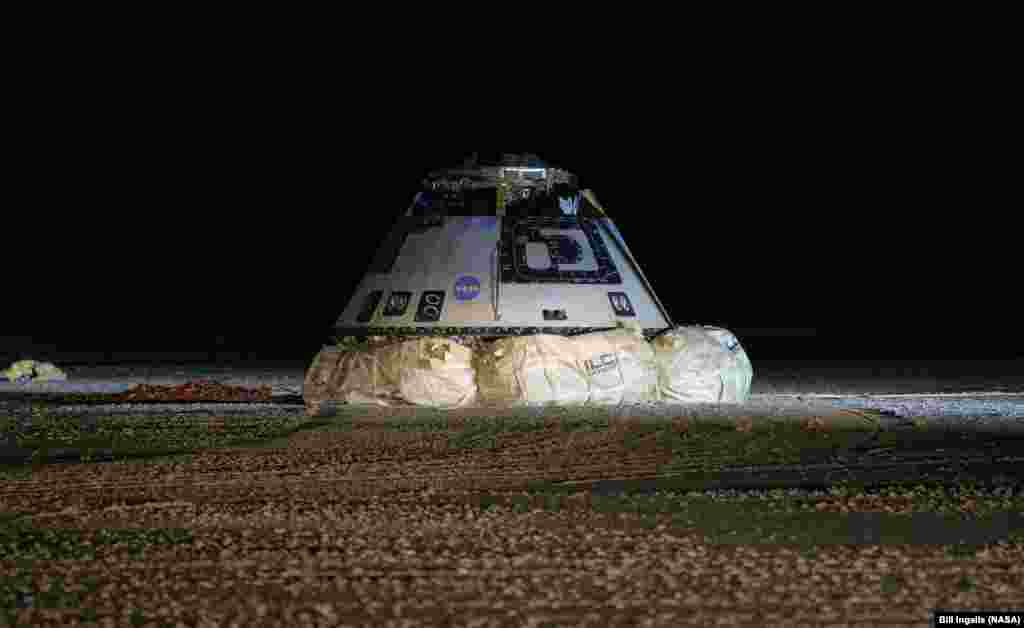 The Boeing CST-100 Starliner spacecraft is seen after it landed in White Sands, New Mexico. The landing completes an abbreviated Orbital Flight Test for the company that still meets several mission objectives for NASA's Commercial Crew program.