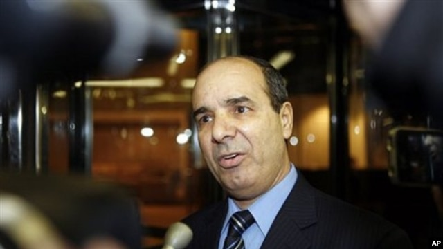 Ibrahim Dabbashi, Libya's deputy ambassador at the United Nations, speaks to reporters at the entrance to the Libyan Mission in New York February 21, 2011