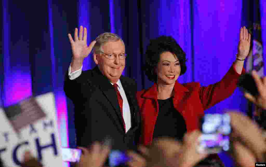 U.S. Senate Minority Leader Mitch McConnell (R-KY) waves to supporters with his wife, former United States Secretary of Labor Elaine Chao, at his midterm election night rally in Louisville, Kentucky, November 4, 2014.