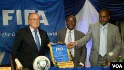 ZIFA president Cuthbert Dube (center) beat his rivals hands down in a poll Saturday