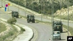 Syrian military vehicles leave Daraa, May 5, 2011 in this still image taken from video