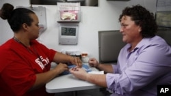 A woman in Los Angeles gets an HIV test.