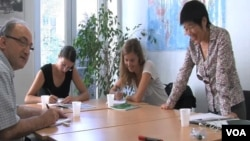 An instructor teaches Mandarin Chinese to a class of language students in Paris.