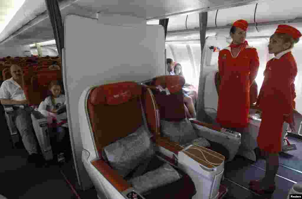 People sit onboard an Aeroflot Airbus A330 heading to the Cuban capital Havana at Moscow's Sheremetyevo airport, Russia. A Russian passenger plane left Moscow for Havana without any sign of former U.S. spy agency contractor Edward Snowden on board, witnesses said.