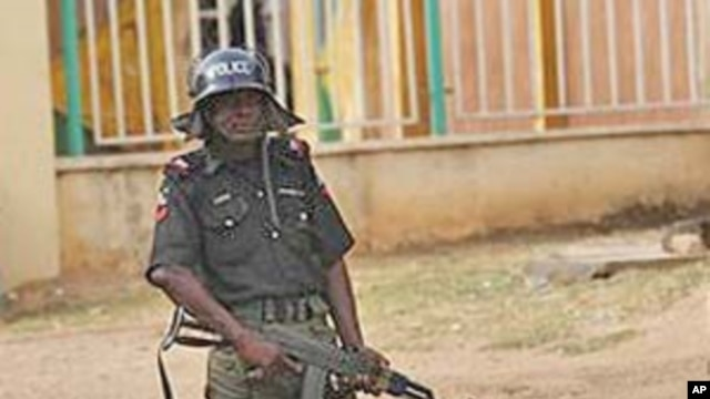 A policeman stands guard in Kaduna, Nigeria, April 21, 2011